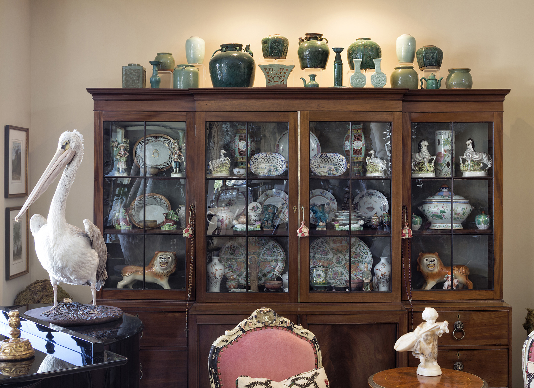 many picture frames and print collections